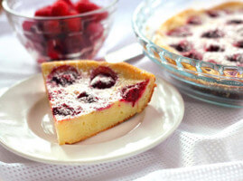 Piece of cottage cheese pie with raspberries